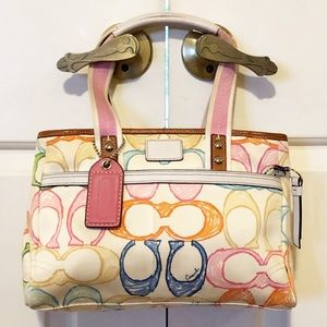 Coach white satchel w colorful logos leather trim.